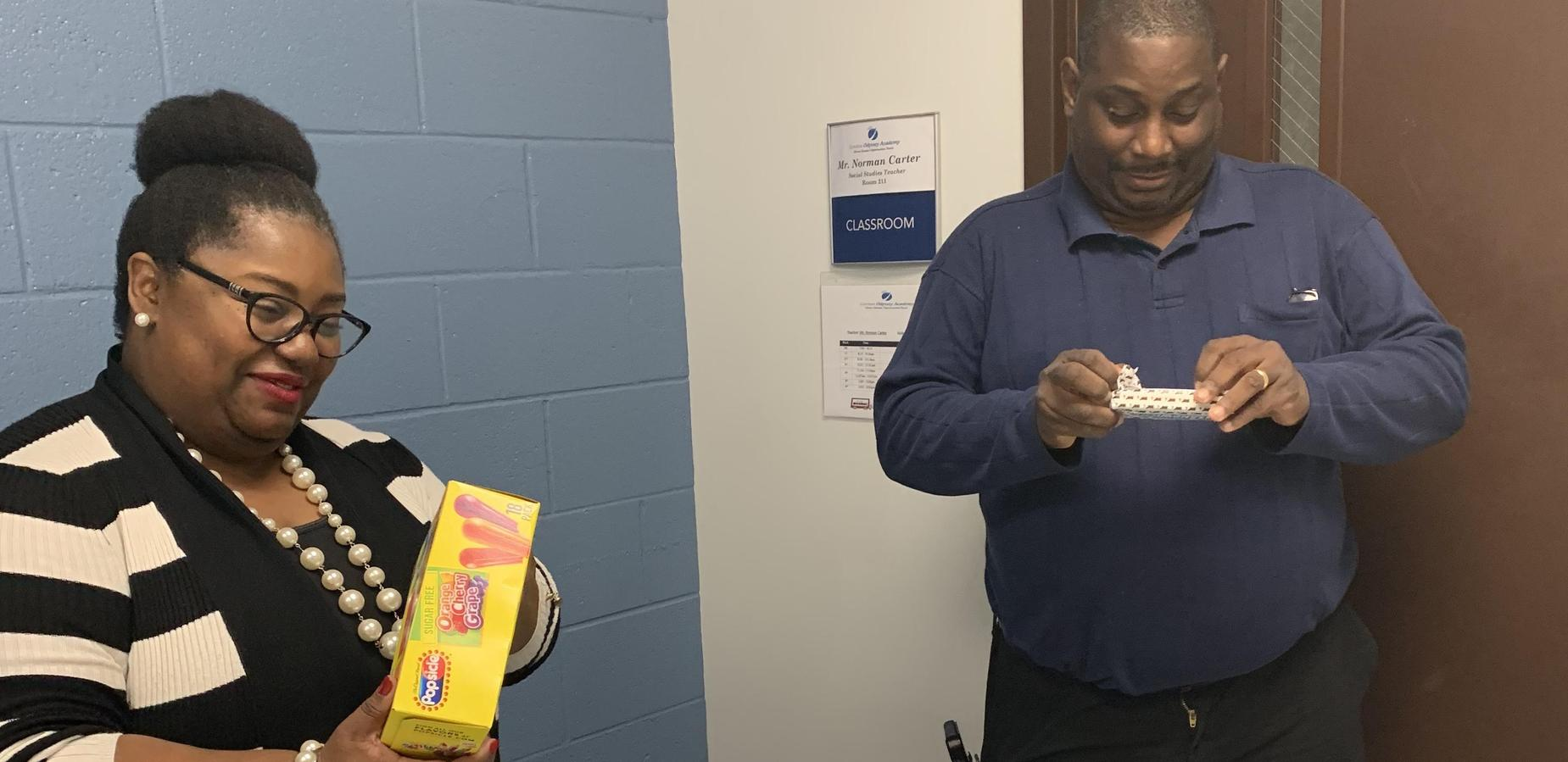 Dr. Tindal honoring Mr. Carter during American Education Week