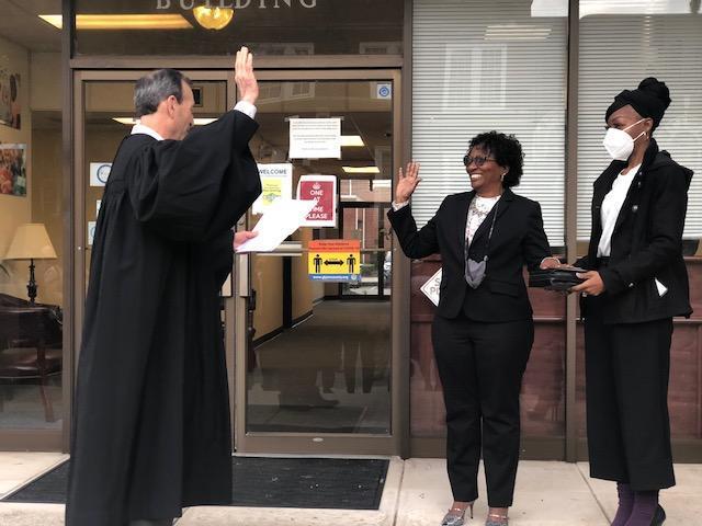 Audrey Gibbons is sworn in by Judge Stephen Kelley.