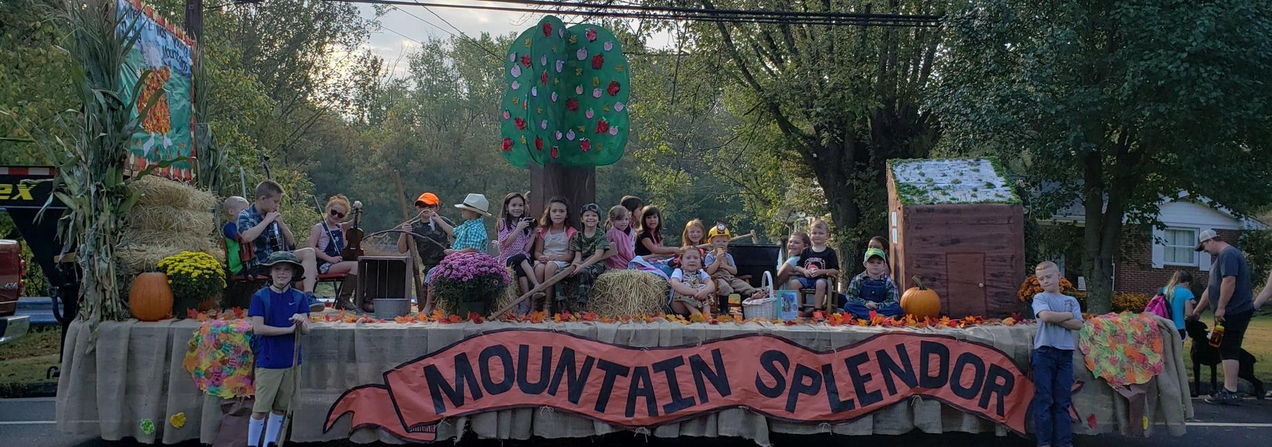 Students on float wait for parade to begin.