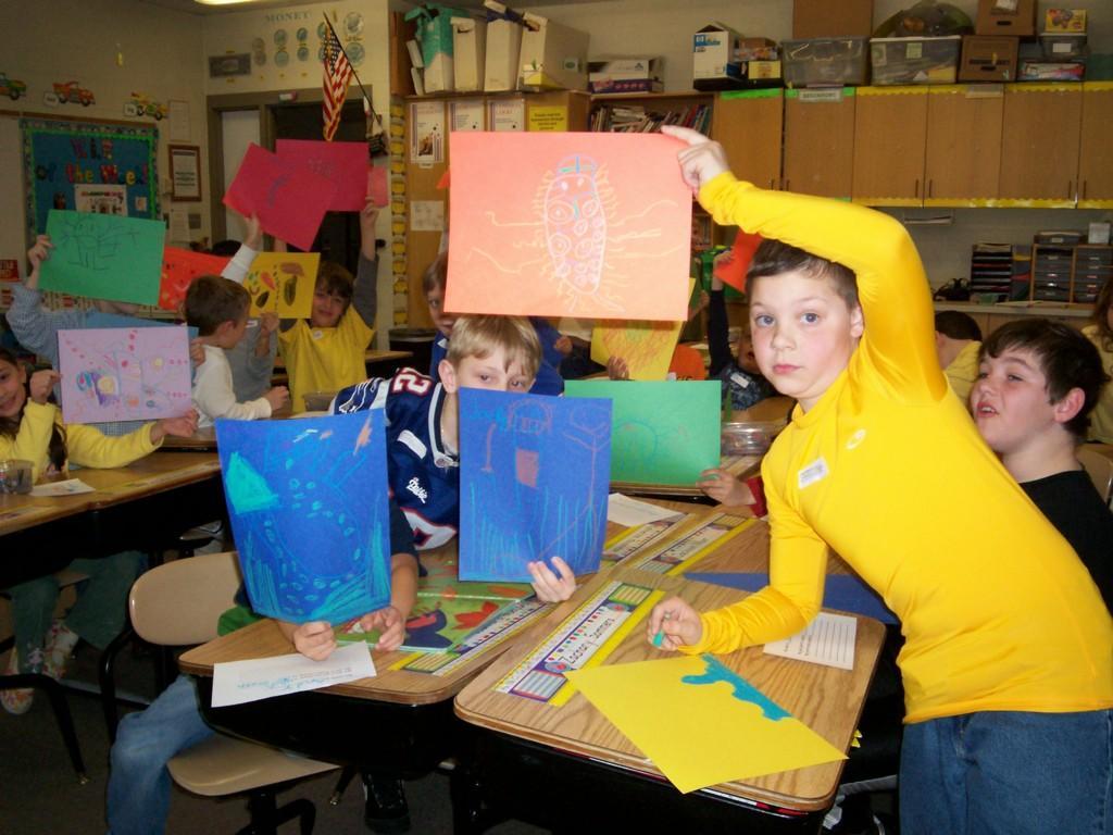 kids show off their artwork in class