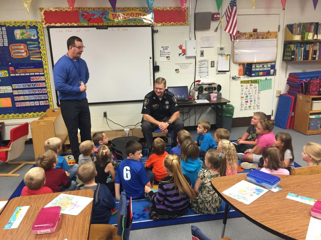 Officer Hebb and Mr. Lance celebrating Red Ribbon Week with students.