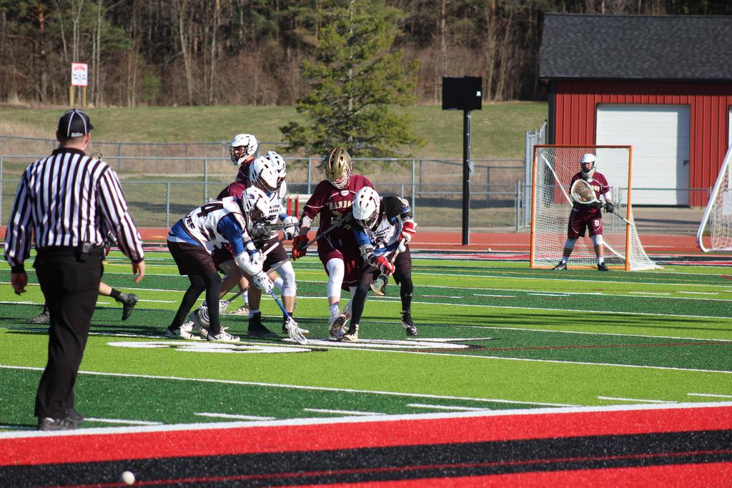 Two teams playing lacrosse