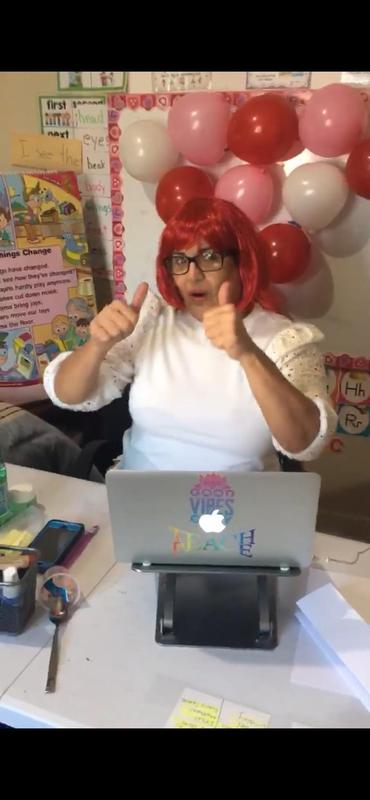 Ms. Torres wearing red wig