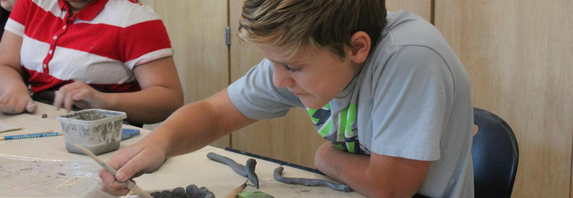 Students working with clay in art class