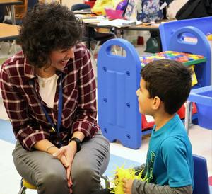 Photo of Lincoln preschool teacher and student exchanging compliments during Week of Respect game.