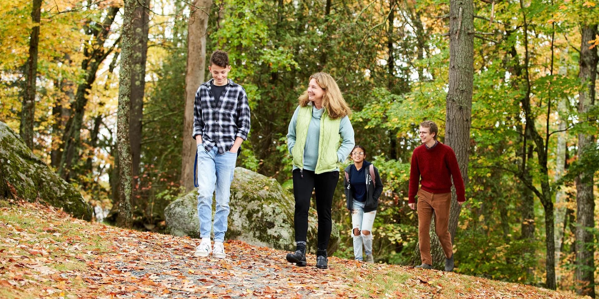 Advisors walking with their advisees on one of the campus trails.