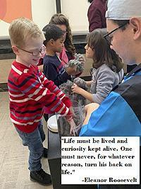 "Image of a Readiness students enjoying a sensory experience. ""Life must be lived and curiosity kept alive. One must never, for whatever reason, turn his back on life."" -Eleanor Roosevelt"