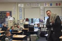 Superintendent Ben Mainka reads to students in classroom