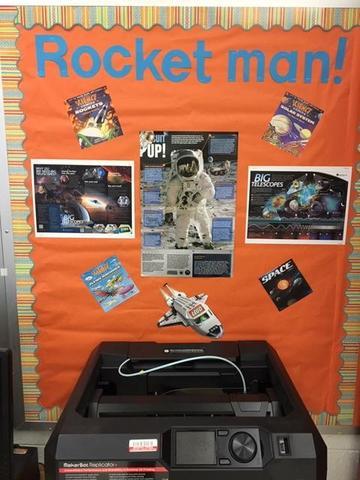 bulletin board that says 'rocket man'