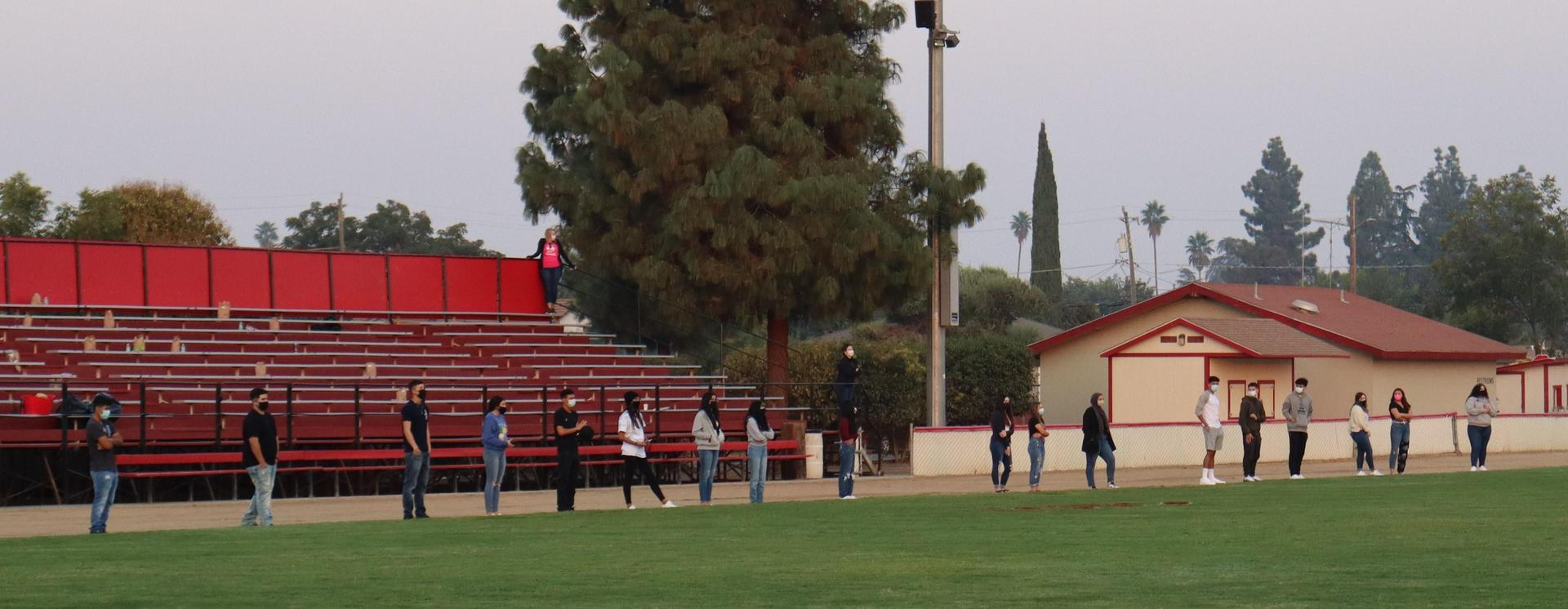 students on sidelines at the end of senior sunrise