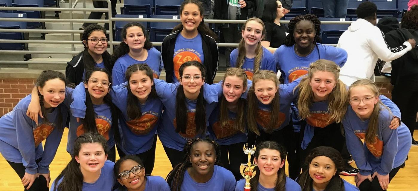 CheyAnnes Drill Team pose together with awards they earned at competition