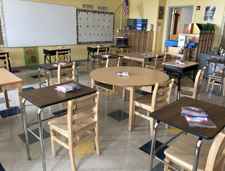 Circle table in middle of desks in classroom