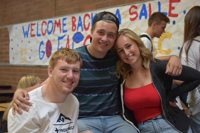 three teens smiling