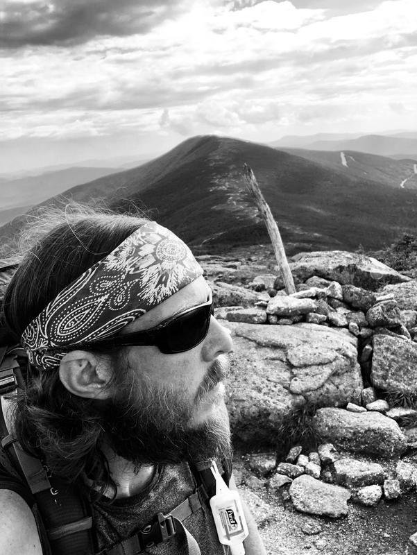 TK alum Adam Holsted sits atop one of the high points along the Appalachian Trail.