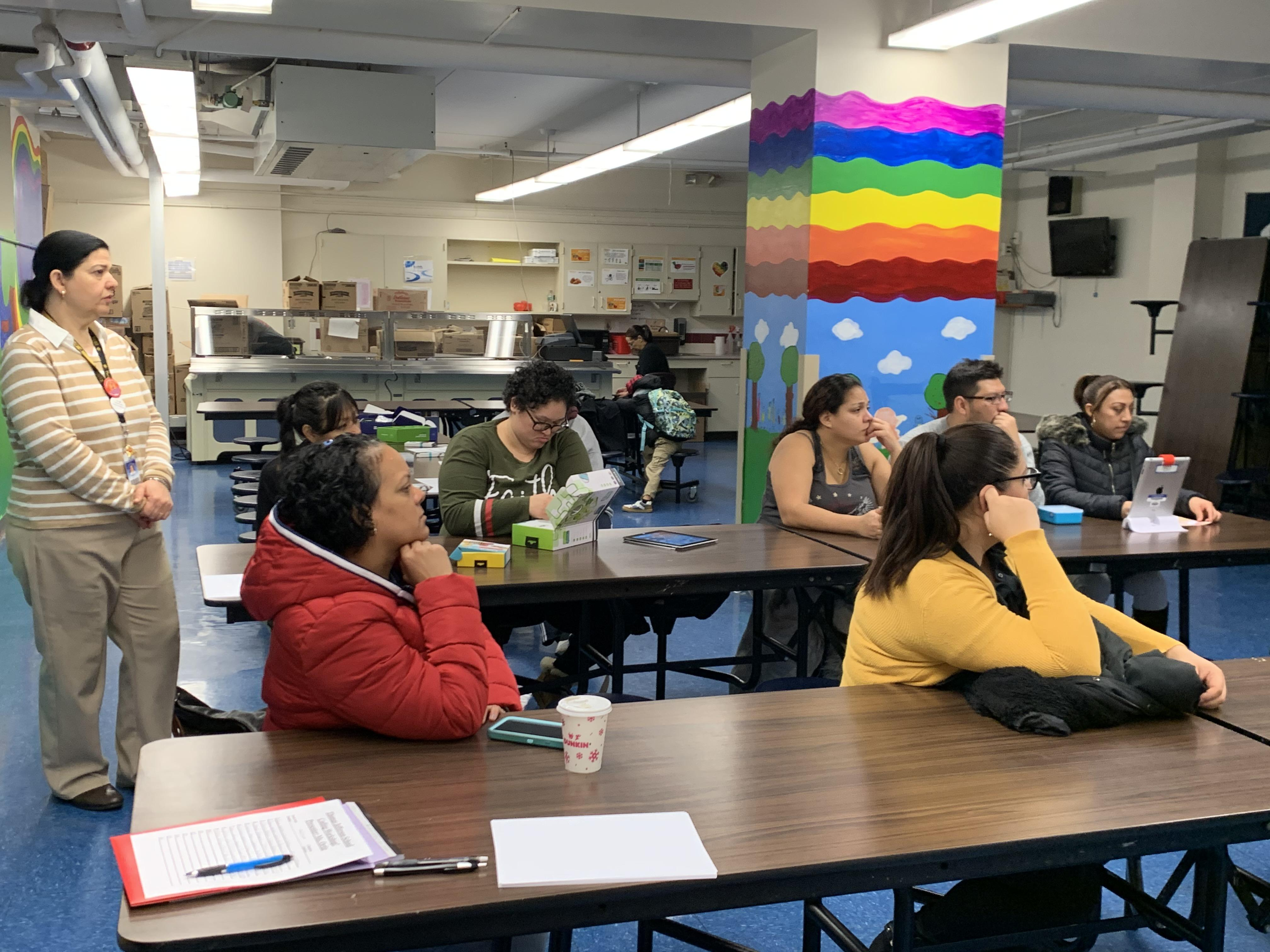 Parents listening to Ms. Ortiz