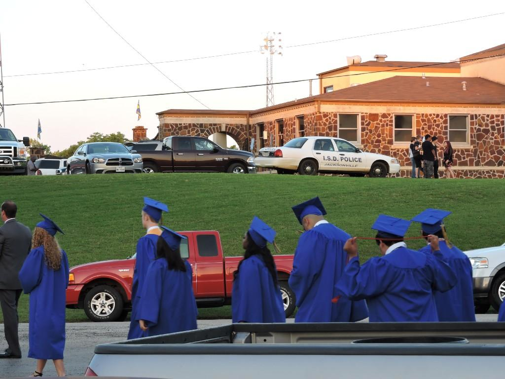 graduates walking to the Tomato Bowl
