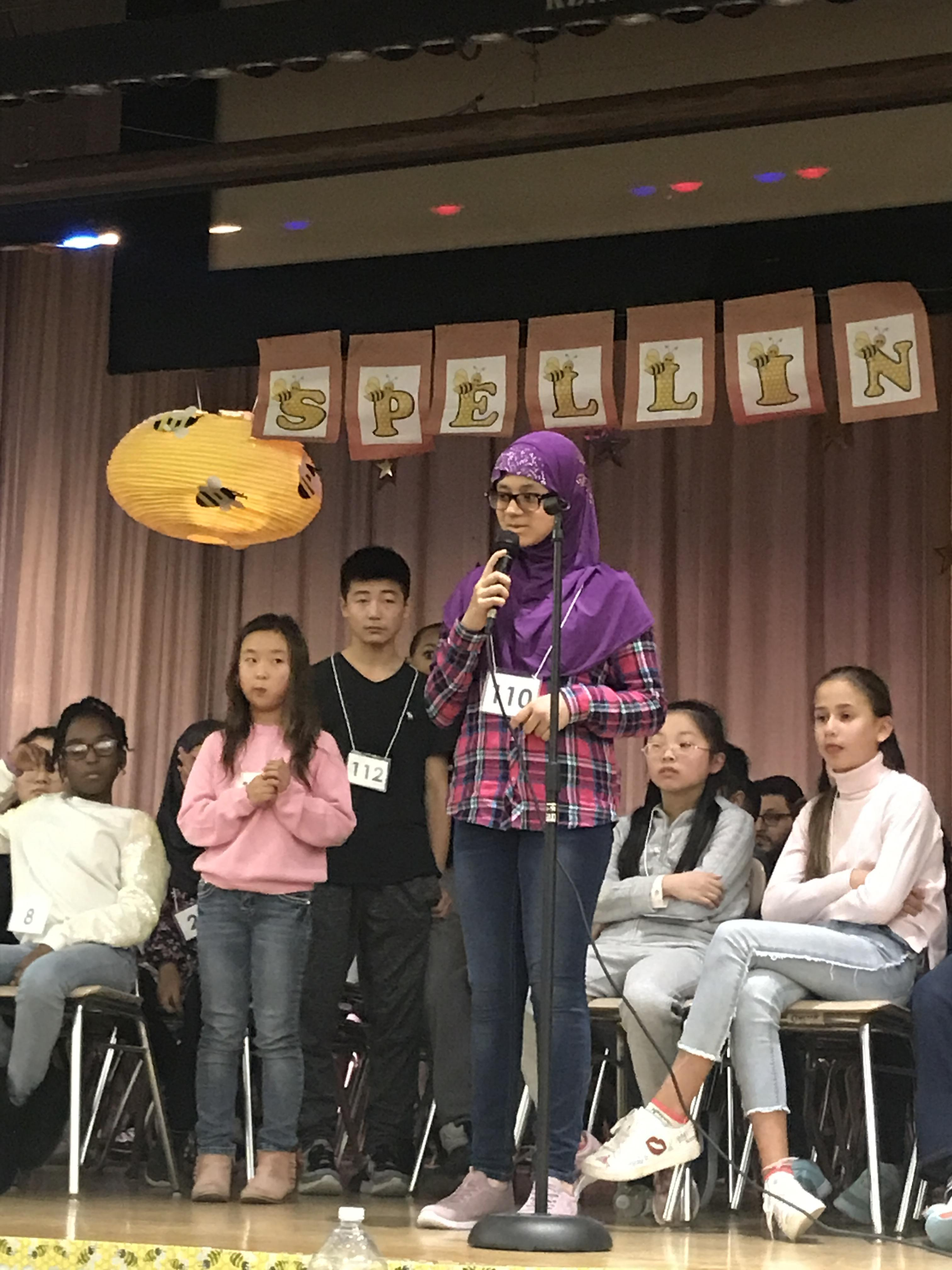 student participating in spelling be