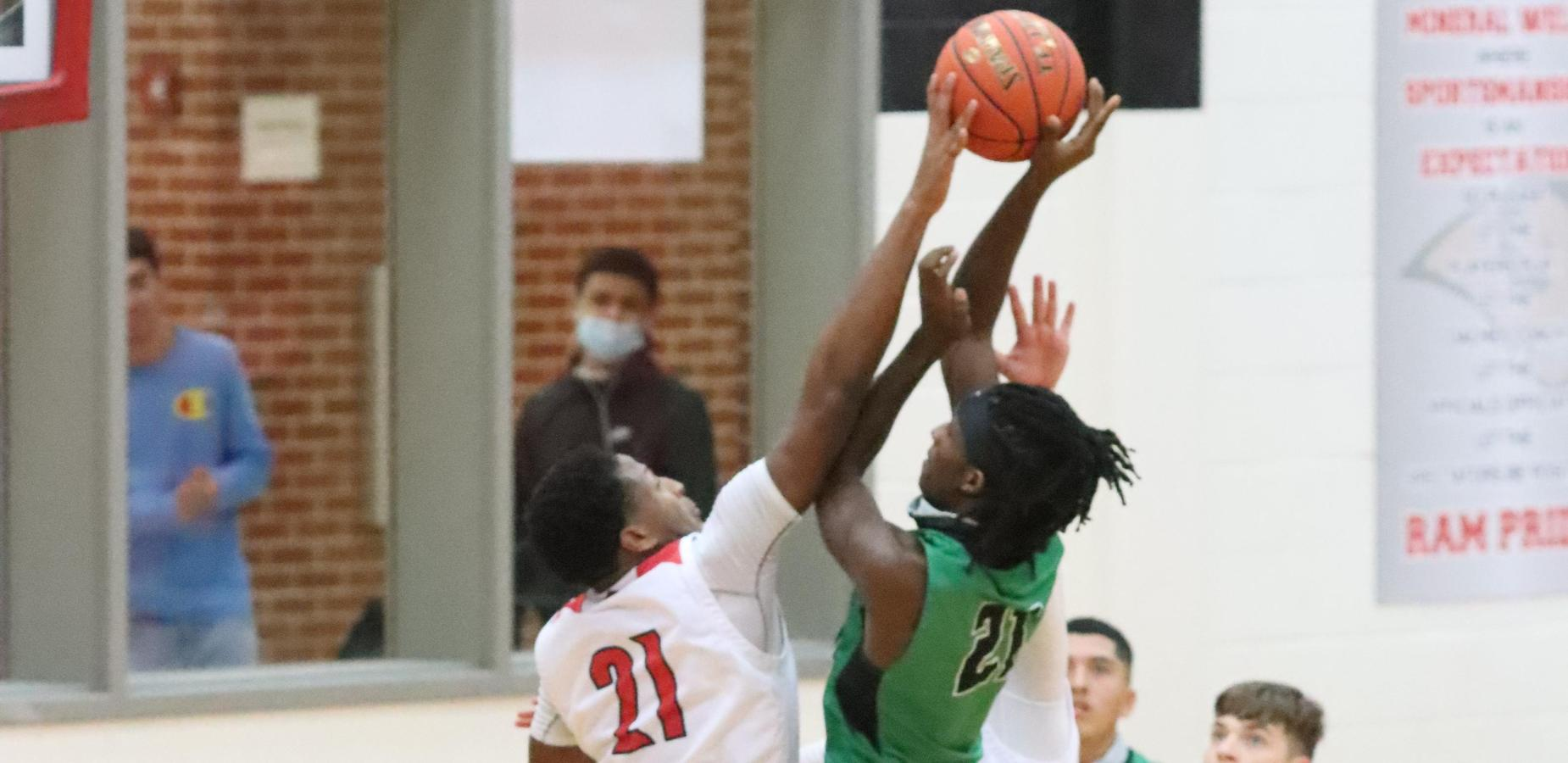 Block by basketball player