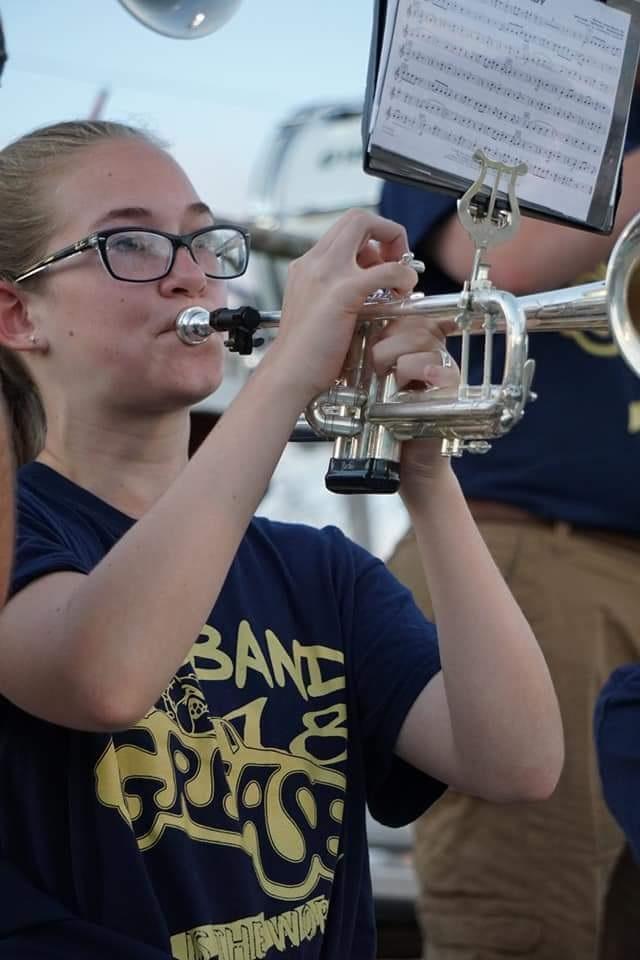 girl playing the tuba