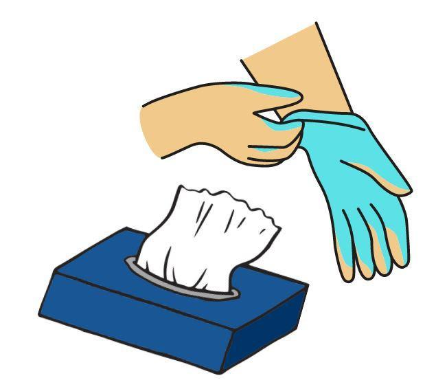 A box of tissues next to a someone who is putting a disposable glove on their hand.