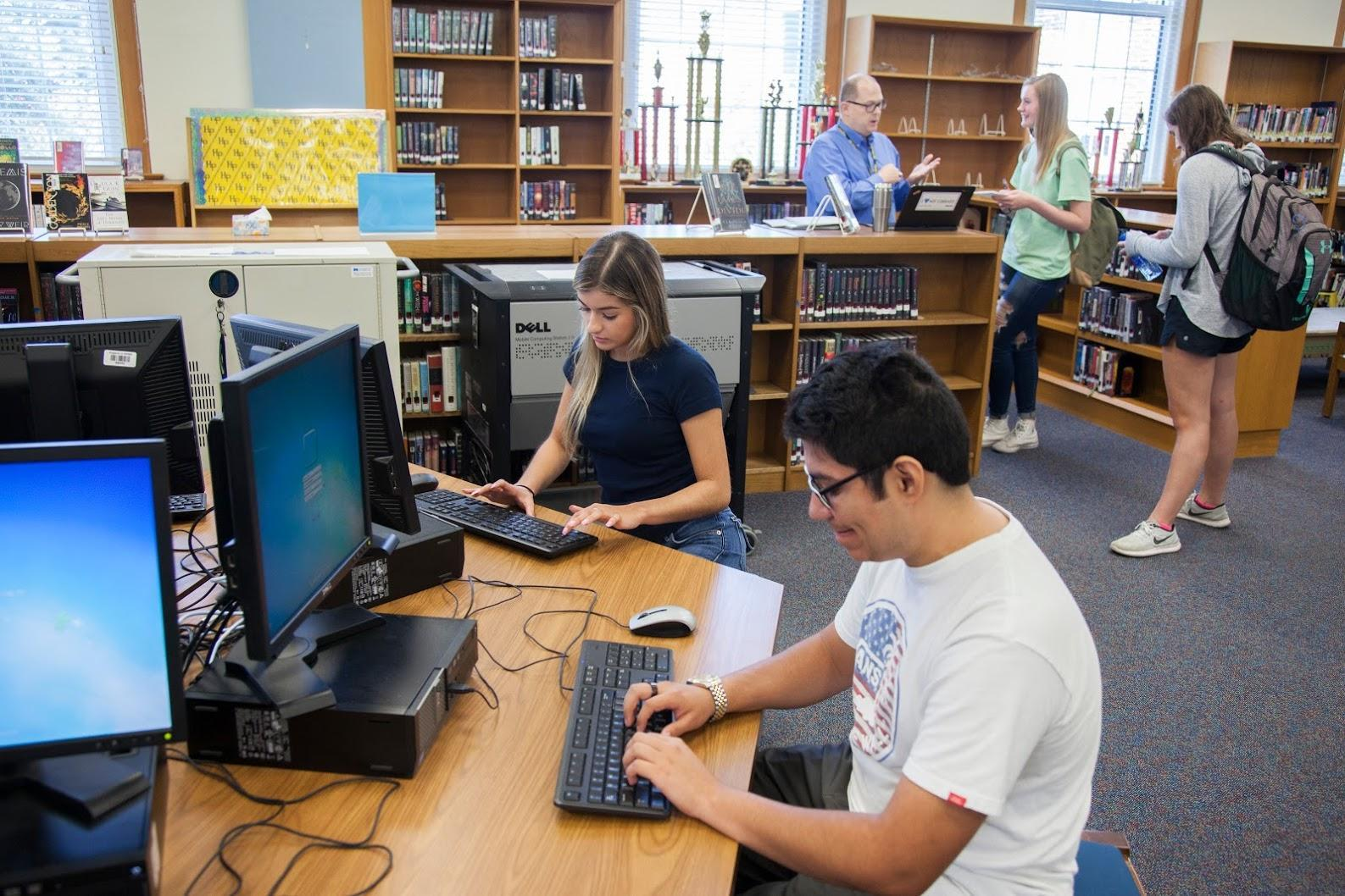 Students working on computers in the high school library