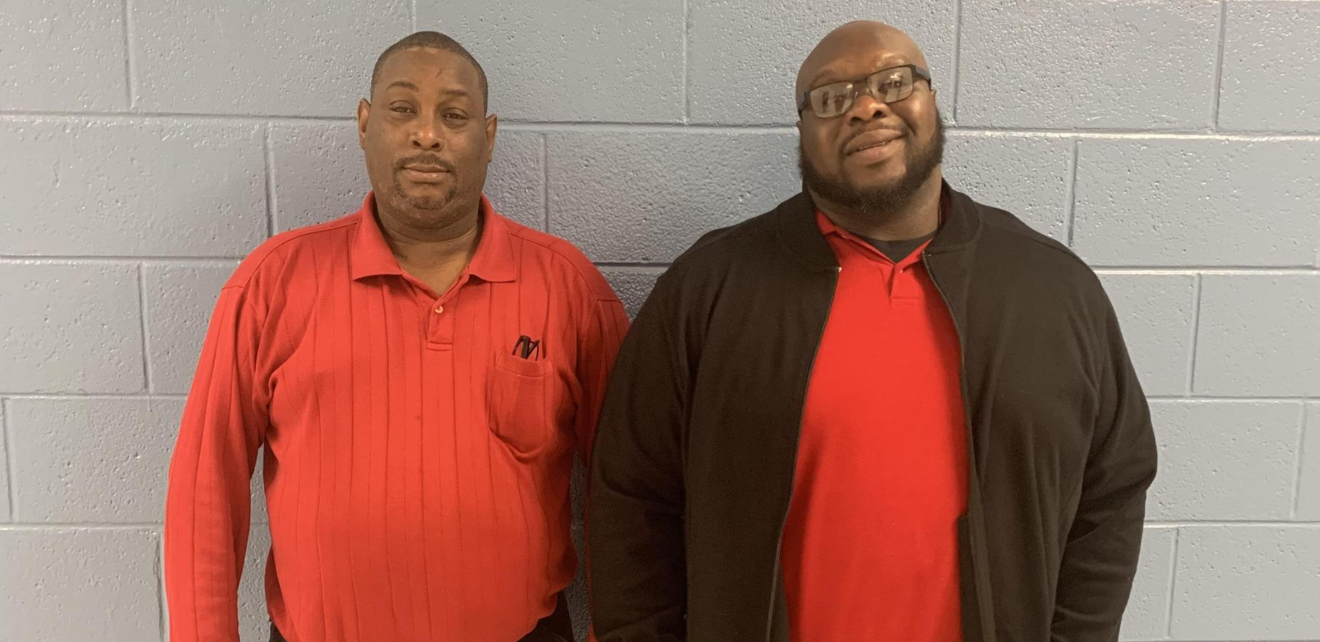 Mr. Bobian and Mr. Carter wearing red for holiday week