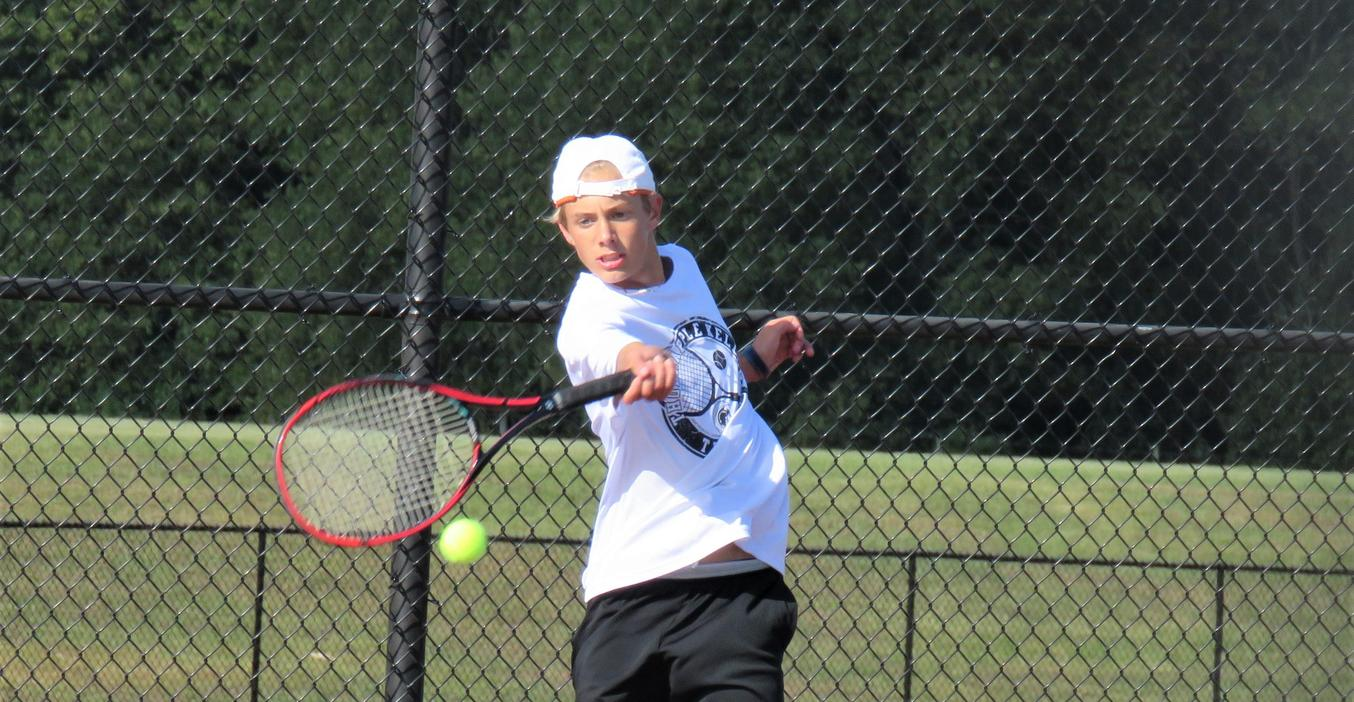 A TKHS tennis player returns a serve.