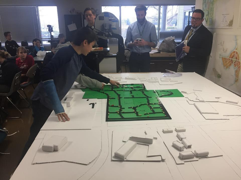 Students present urban planning ideas to city professionals