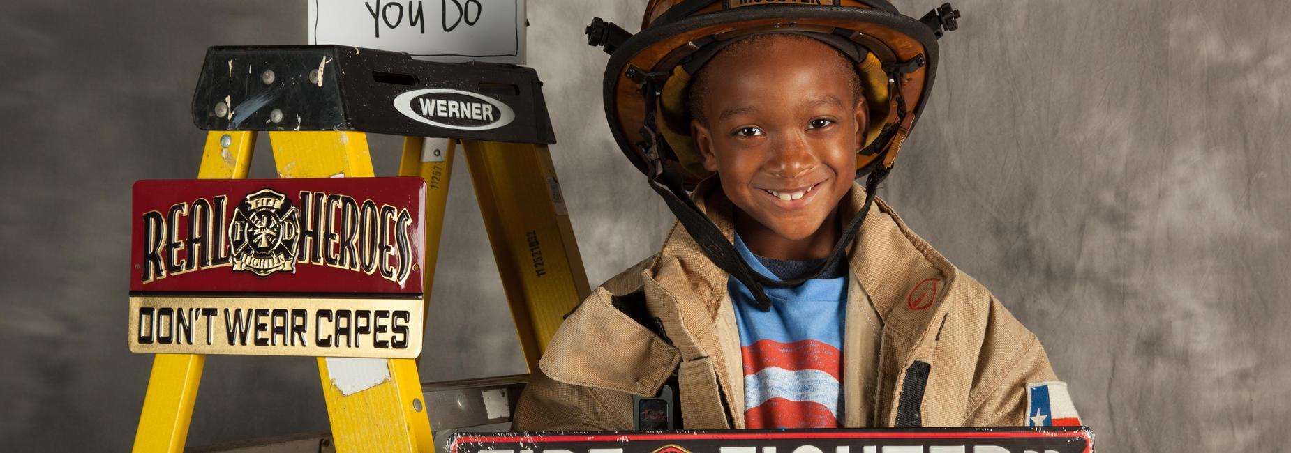 elementary boy in firefighter uniform