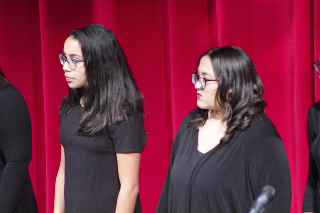 A close-up of two members of the choir