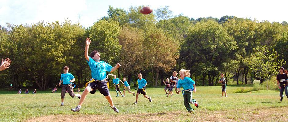 Flag football player jumps into the air.