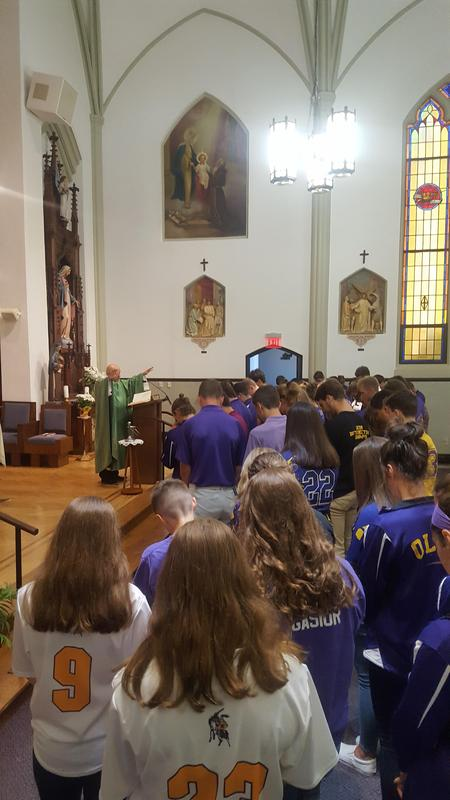 photo of OLSH fall student-athletes receiving a special blessing at Mass