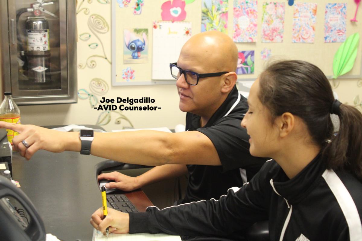 Joseph Delgadillo helping a student