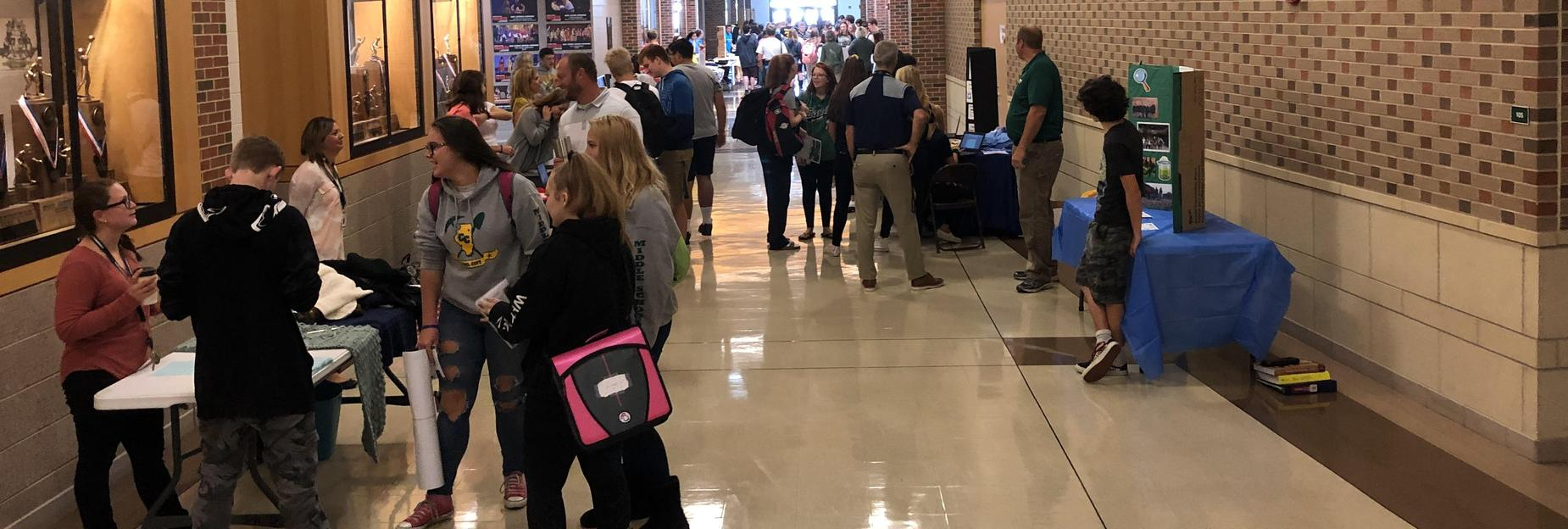Packed hallways learning about clubs