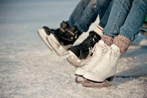 3 pairs of ice skates on the ice