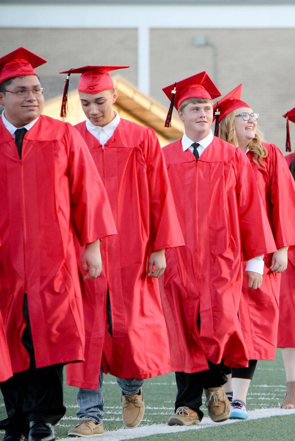 students of the victoria east high school 2018 graduating walking into memorial stadium, students smiling in the stands