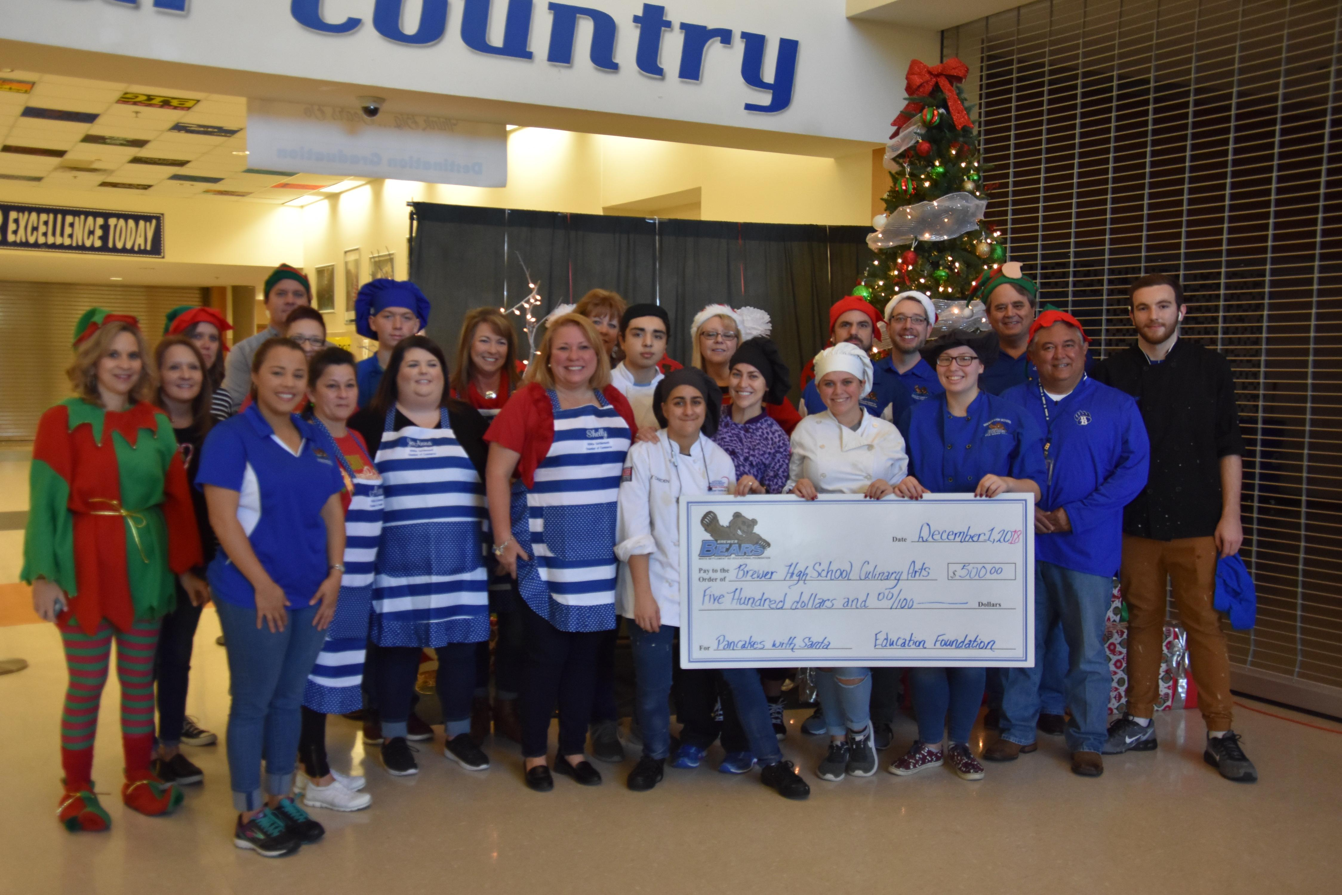 The WSISD Education Foundation and the White Settlement Chamber of Commerce sponsored our 3rd annual Pancakes with Santa event on Dec. 1. They awarded $500 to the Brewer Culinary Arts program for preparing the meal.