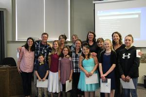 Image of Animas Valley Elementary teachers being recognized by Board President Nancy Stubbs