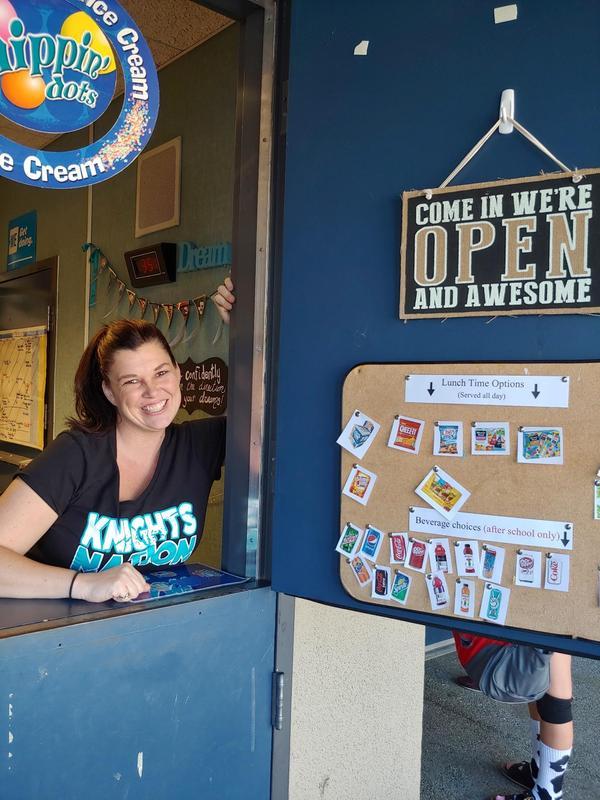 Heather Reynoso standing in the ASB clerk window