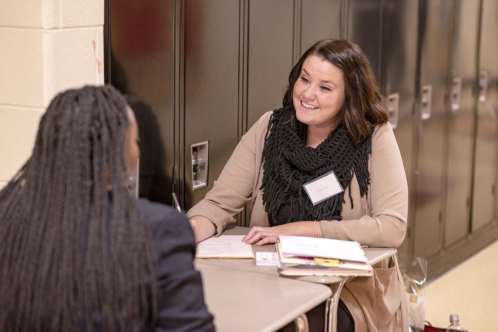 English Director Katie O'Neil smiles at a student