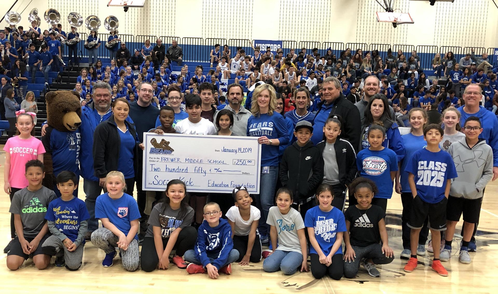 The Foundation awarded a $500 during the Brewer Winter Sports Rally.