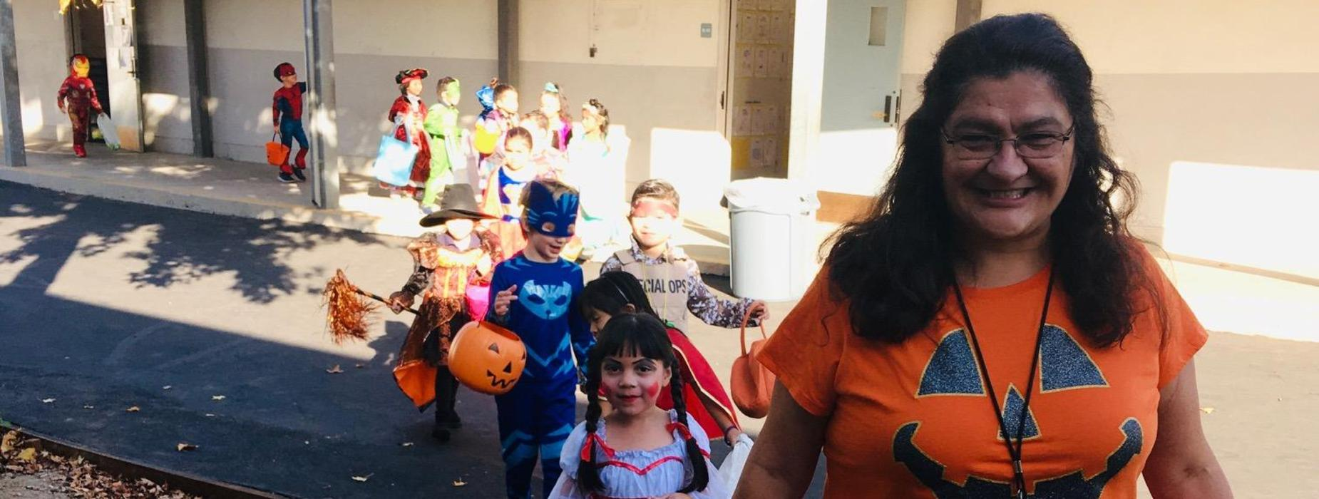 Ms. Mendoza and class during Halloween