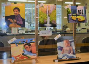 Student artwork displayed in high school lobby