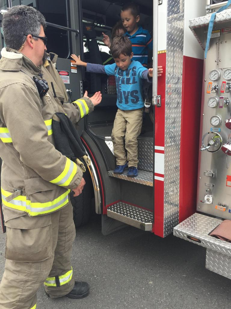 Firemen helping student