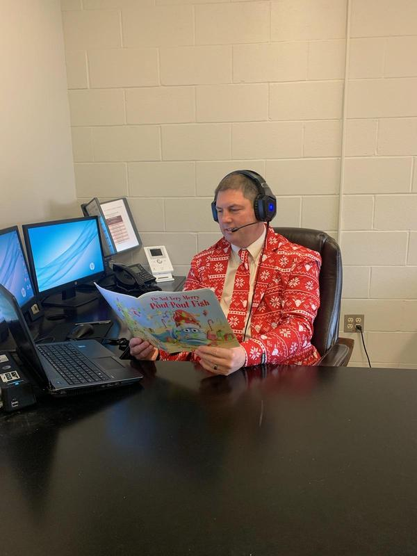 Superintendent Robydek reading holiday book.