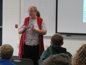 TKMS teacher Rojean Sprague tells students about a fundraising effort to assist veterans.