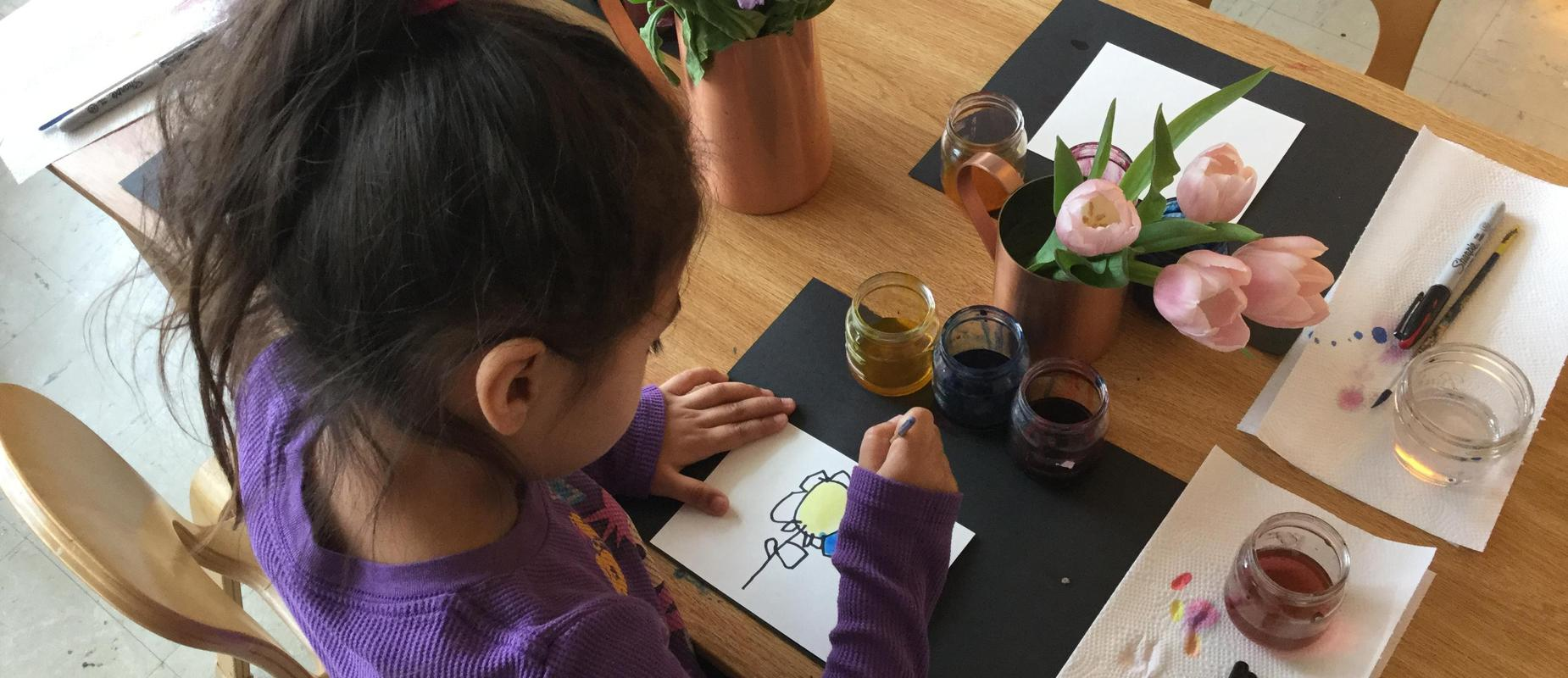 girl painting flowers