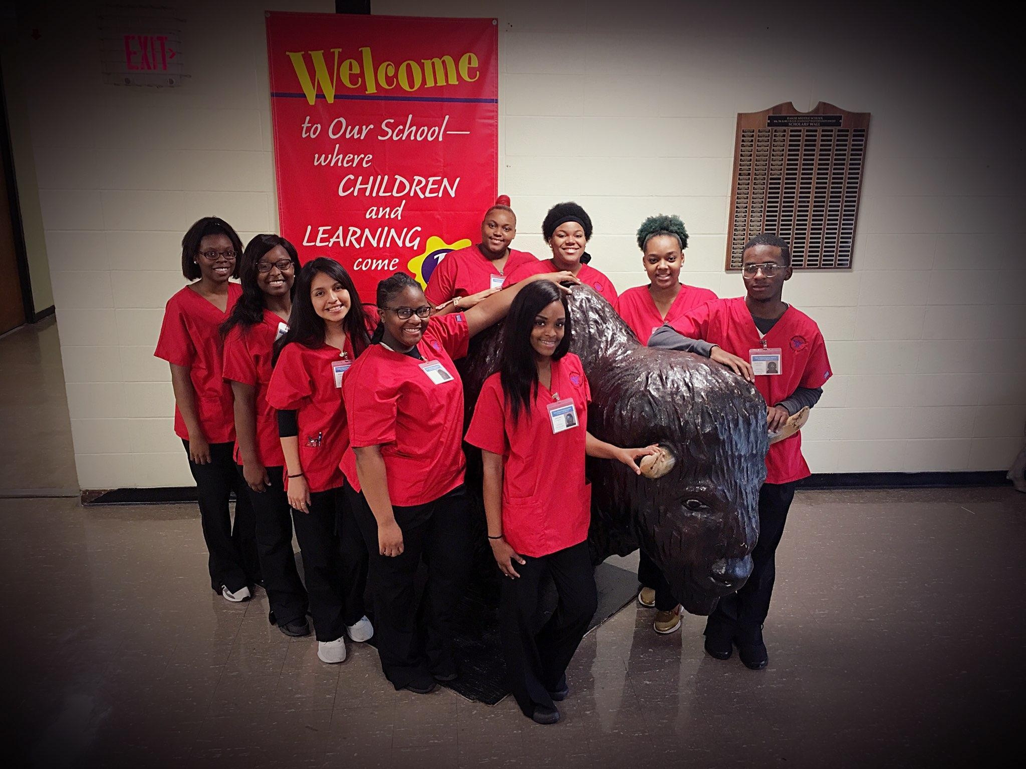 Photo of Baker High School's 1st Nursing Assistant Class standing by the big buffalo