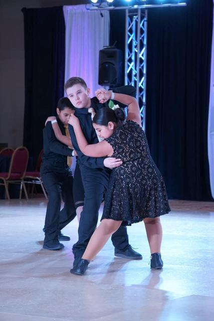 one couple in the middle of a dance move