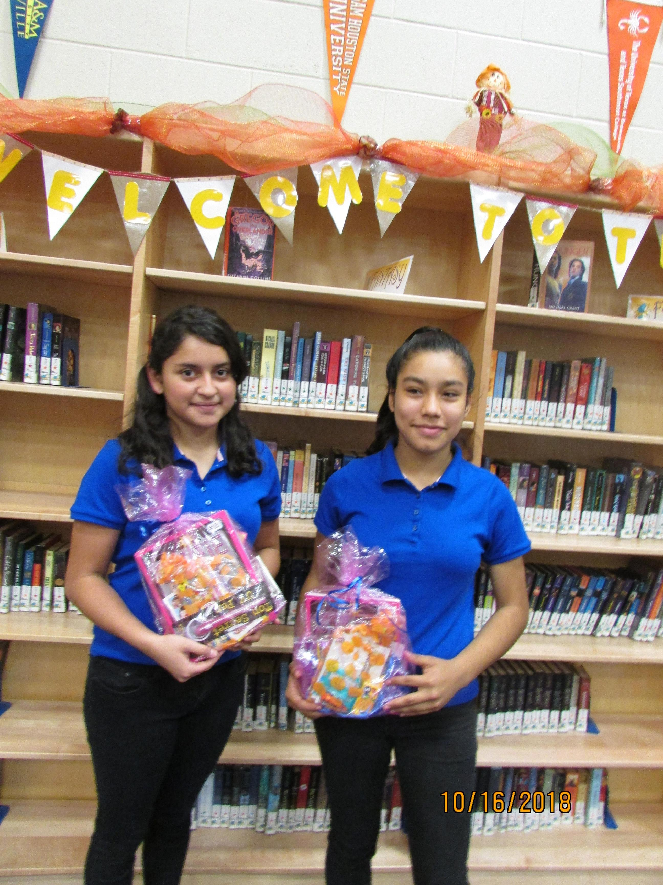 Photo of students who won 'Guess How Many Books?' contest.